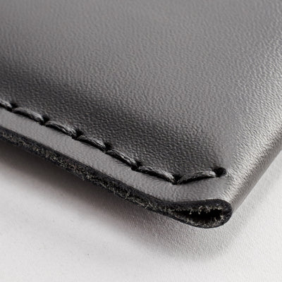 Handstitching close up. Mens leather sleeve. iPad leather folio