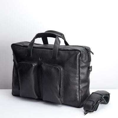 Angle black handmade leather messenger bag for men. Commuter bag, laptop leather bag by Capra Leather.