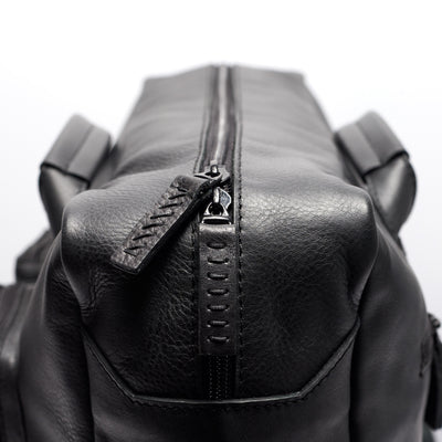 Detail black handmade leather messenger bag for men. Commuter bag, laptop leather bag by Capra Leather.