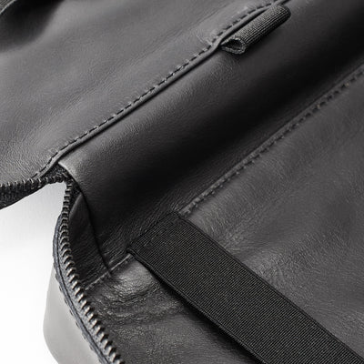 Leather interior detail. Men's handmade black tech laptop tablet bag for travelers.