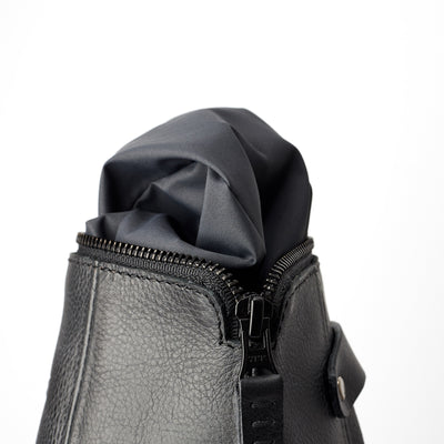 Detail, waterproof interior, hand stitched pull tabs. Black leather boxer toiletry bag. Mens leather dopp kit travel bag