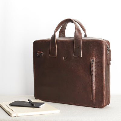 Style. Soft leather briefcase dark brown color