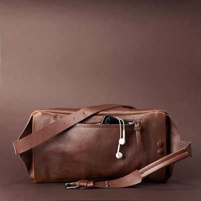 Brown Fenek sling bag backpack made by Capra Leather. Styling back pocket of leather crossbody for easy access.