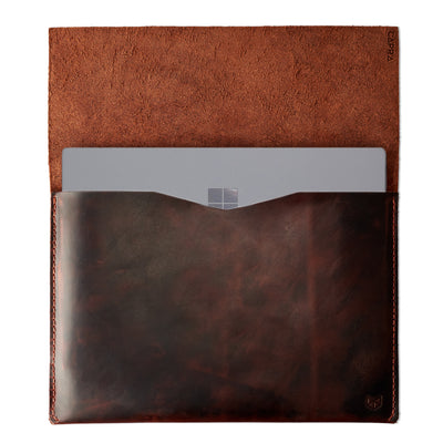 Open. Red brown  leather Surface sleeve. Designer unique mens cases.