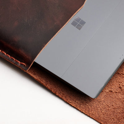 Interior detail. Red brown  leather Surface sleeve. Designer unique mens cases.