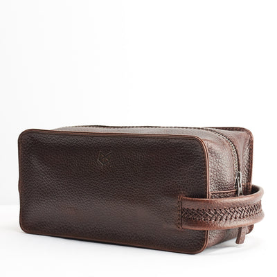 Angle. Dark Brown leather toiletry, shaving bag with hand stitched handle. Groomsmen gifts