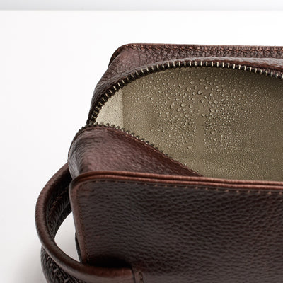 Waterproof interior. Dark Brown leather toiletry, shaving bag with hand stitched handle. Groomsmen gifts