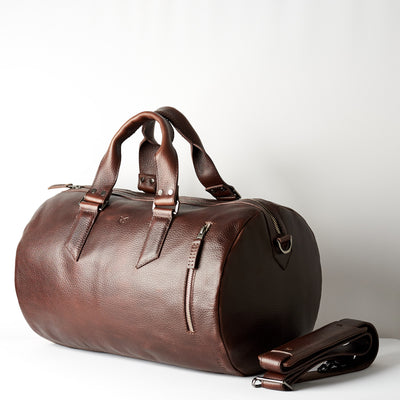 Duffle with padded shoulder strap. Dark brown leather carryall bag. Mens travel weekender bag