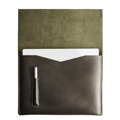 Open. Green Pixelbook Chromebook leather sleeve with  pencil holder