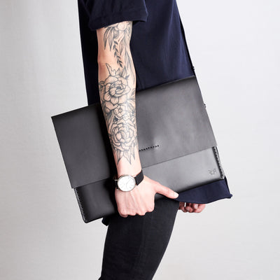 Style side walking view. Black draftsman 1 case by Capra Leather. ZenBook sleeve.