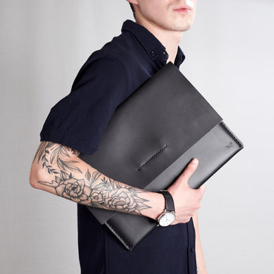 Style side walking view. Black draftsman 1 case by Capra Leather. Google pixel book sleeve.