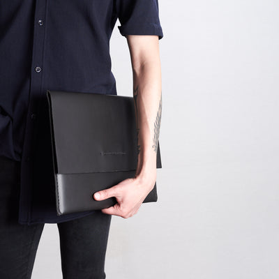 Style side model view of case. Black draftsman 1 case by Capra Leather. ZenBook sleeve.