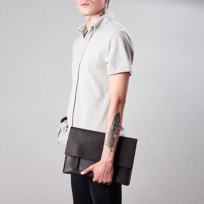 Style hold by model. Marron draftsman 2 case by Capra Leather. Microsoft Surface sleeve.