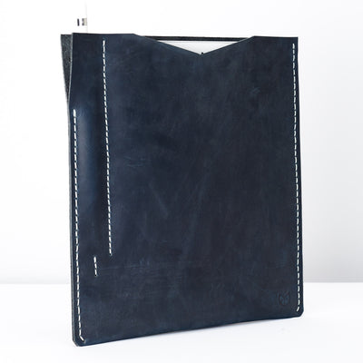 Side from the slim iPad pro sleeve. Blue iPad pro leather sleeve with apple pencil holder