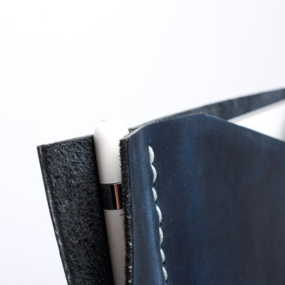 Apple pencil detail. Blue iPad pro leather case with pen holder. Soft leather interior