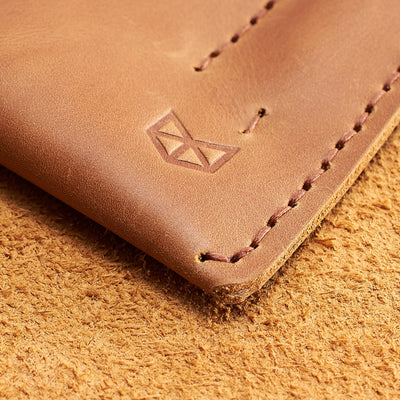 Hand stitch detail. Light brown handcrafted leather reMarkable tablet case. Folio with Marker holder. Paper E-ink tablet minimalist sleeve design.