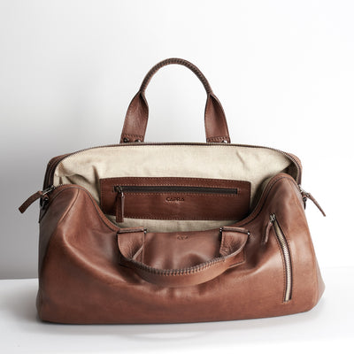 Linen interior. Brown leather handbag duffle bag for men
