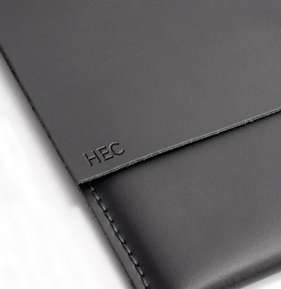 Engraving detail . ASUS Zenbook Pro Duo Black leather case with pen holder. ASUS laptop mens folio