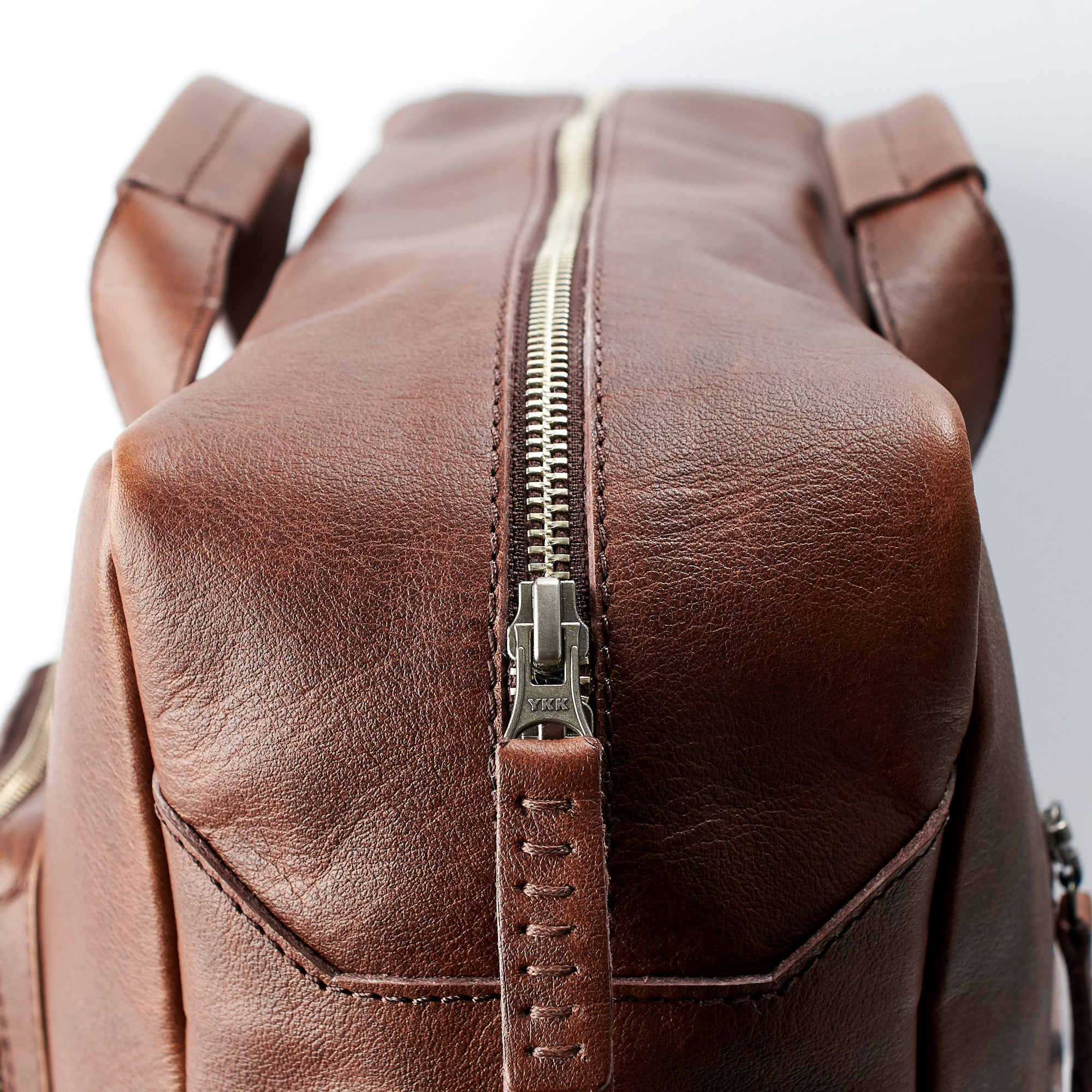 Zipper detail. Hand stitched pull tabs. Brown handmade leather messenger bag  for men. 2941b0d71b