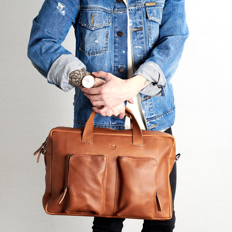 Front view. Tan handmade leather messenger bag for Men by Capra Leather. Tech bag, mens weekender bag