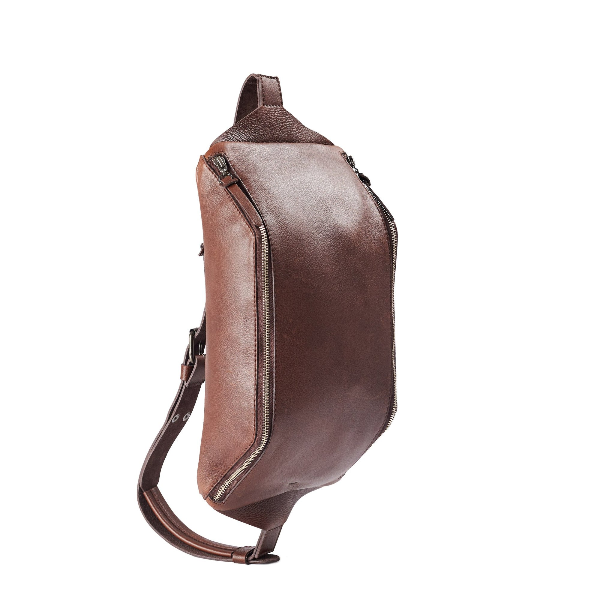 Brown Fenek sling bag backpack made by Capra Leather. Frontal view of small backpack with single strap.