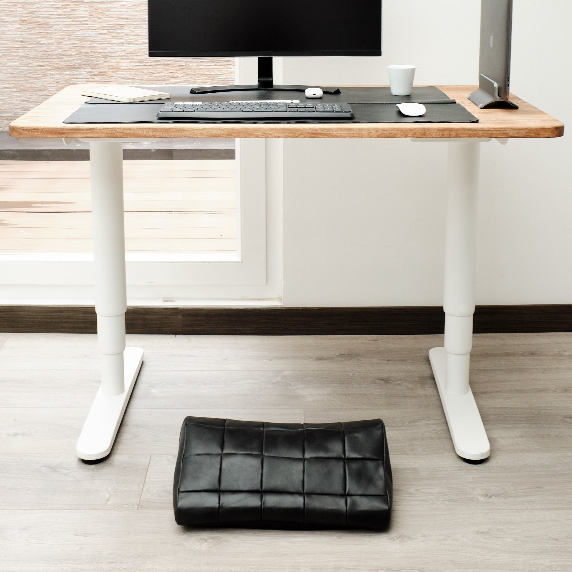 Cover. Ergonomic under desk footrest cover in black by Capra Leather