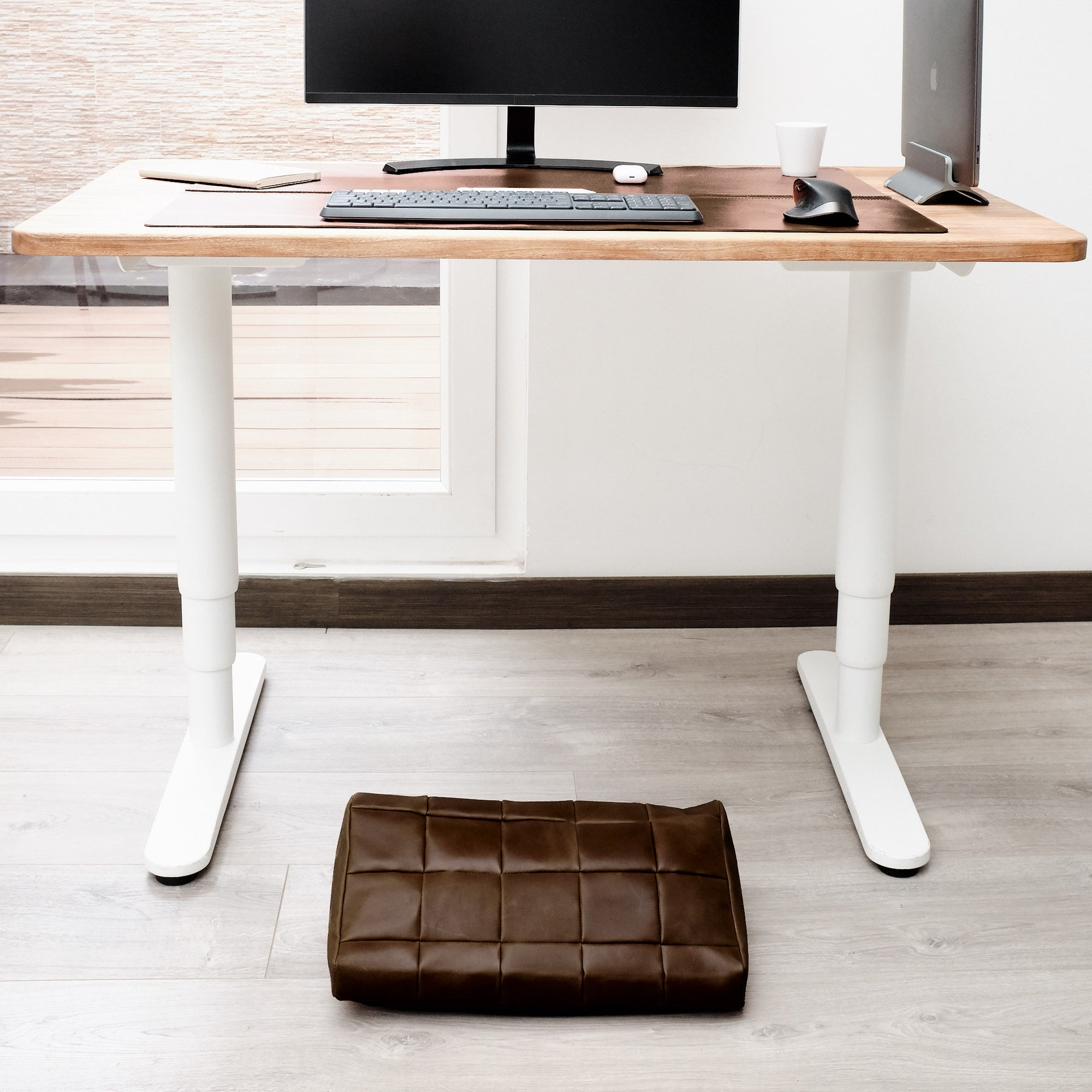 Cover. Ergonomic under desk footrest cover in brown by Capra Leather