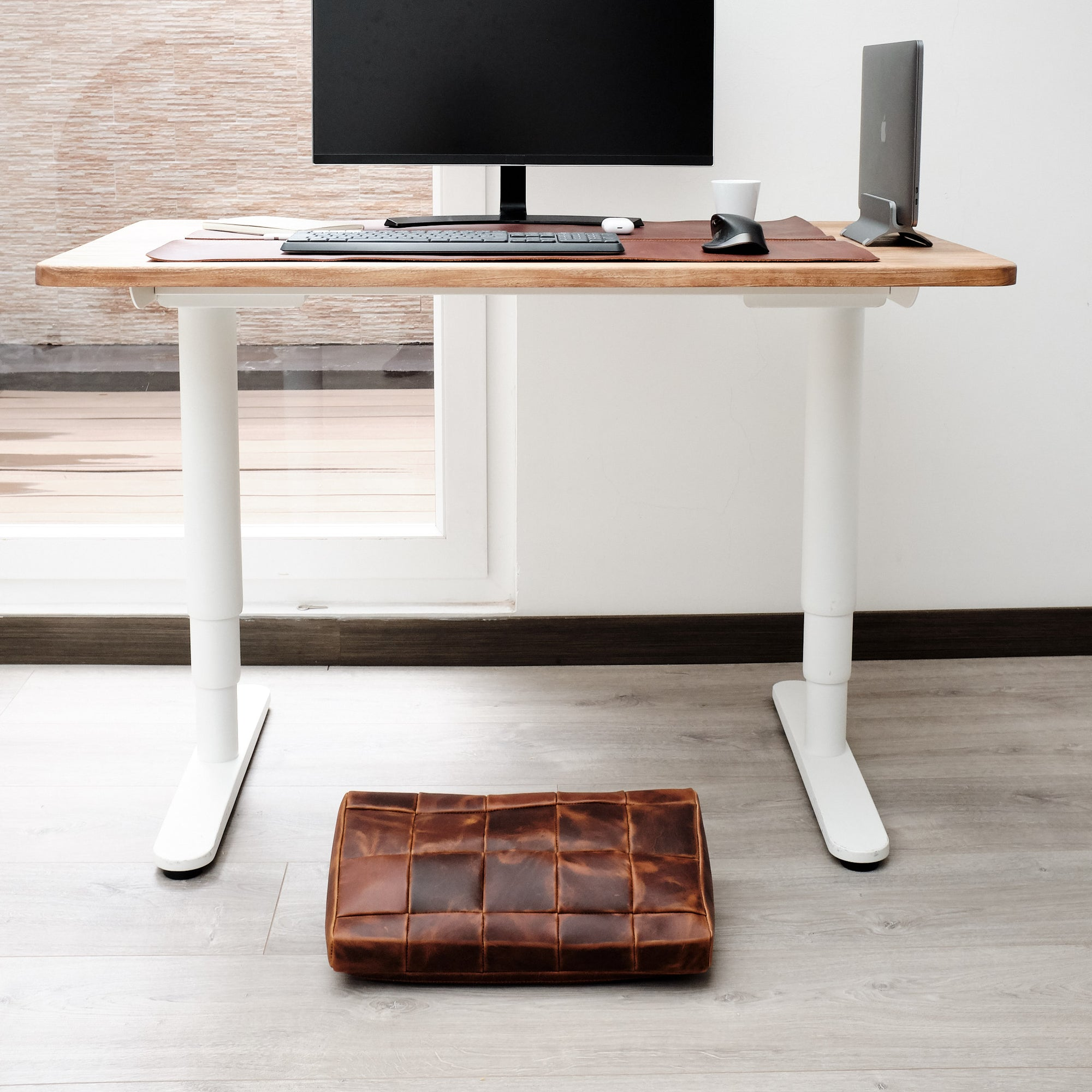 Cover. Ergonomic under desk footrest cover in distressed tan by Capra Leather