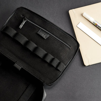 Linen interior. Black leather gadget bag, tech dopp kit, electronic organizer. Fits iPad Pro with Apple pencil.