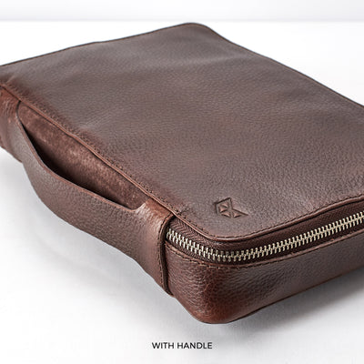 Handle detail.  Dark Brown leather gadget bag, tech dopp kit, electronic organizer. Fits iPad Pro with Apple pencil.