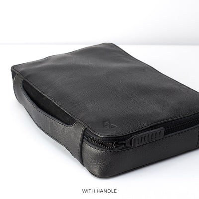 Handle detail.  Black leather gadget bag, tech dopp kit, electronic organizer. Fits iPad Pro with Apple pencil.