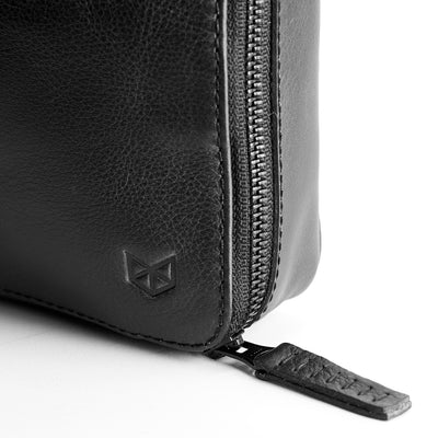 Metallic YKK zippers. Black leather gadget bag, tech dopp kit, electronic organizer. Fits iPad pro