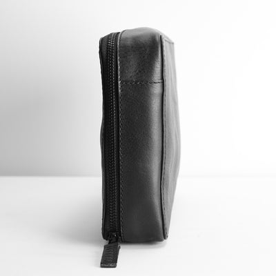 Slim profile. Black leather gadget bag, tech dopp kit, electronic organizer.