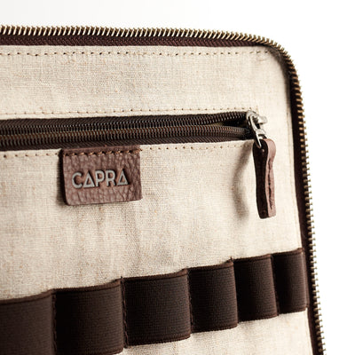 Interior detail. Men's brown leather 15 inch tech laptop tablet bag is perfect to travel organized.