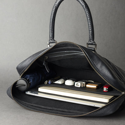 Interior in use .Black leather briefcase laptop bag for men. Gazeli laptop briefcase by Capra Leather.