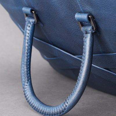 Hand stitch cylindrical handle detail. Blue leather briefcase laptop bag for men. Gazeli laptop briefcase by Capra Leather.