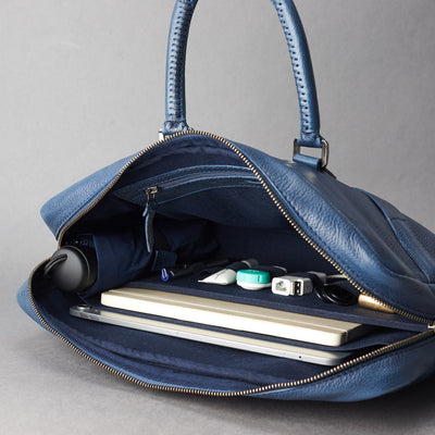 Interior in use .Blue leather briefcase laptop bag for men. Gazeli laptop briefcase by Capra Leather.