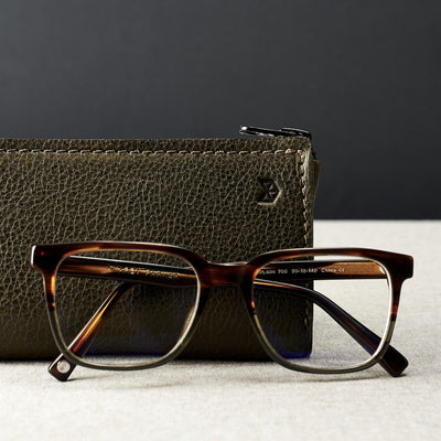 Style photo. Green leather glasses case for men. Eyewear mens leather sleeve