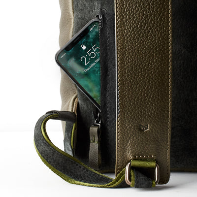 Cellphone backpack ocket. 15 inch Macbook pro pocket. Green leather backpack with linen interior