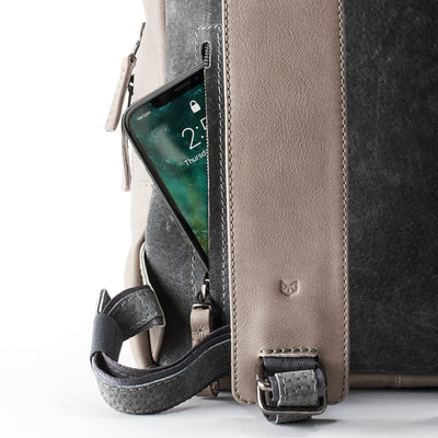 Phone pocket. Grey full grain leather mens backpack with laptop padded pocket