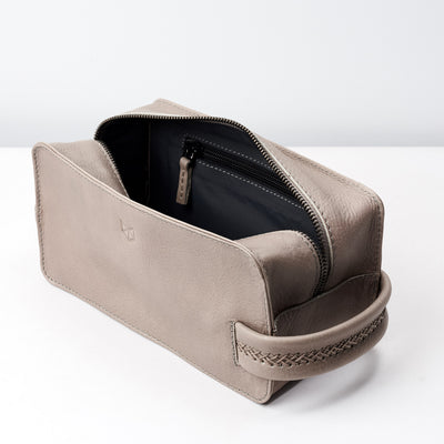 Leather toiletry bag with interior pocket for small essentials. Grey leather shaving bag for mens gifts