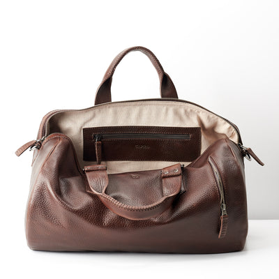 Linen interior. Dark brown leather handbag duffle bag for men