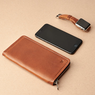Styling Apple. Tan iPhone leather wallet stand case for mens gifts. iPhone xs, iPhone xs Max, iPhone xr, iPhone x, iPhone 10, iPhone 8 plus leather stand sleeve. Crafted by Capra Leather.