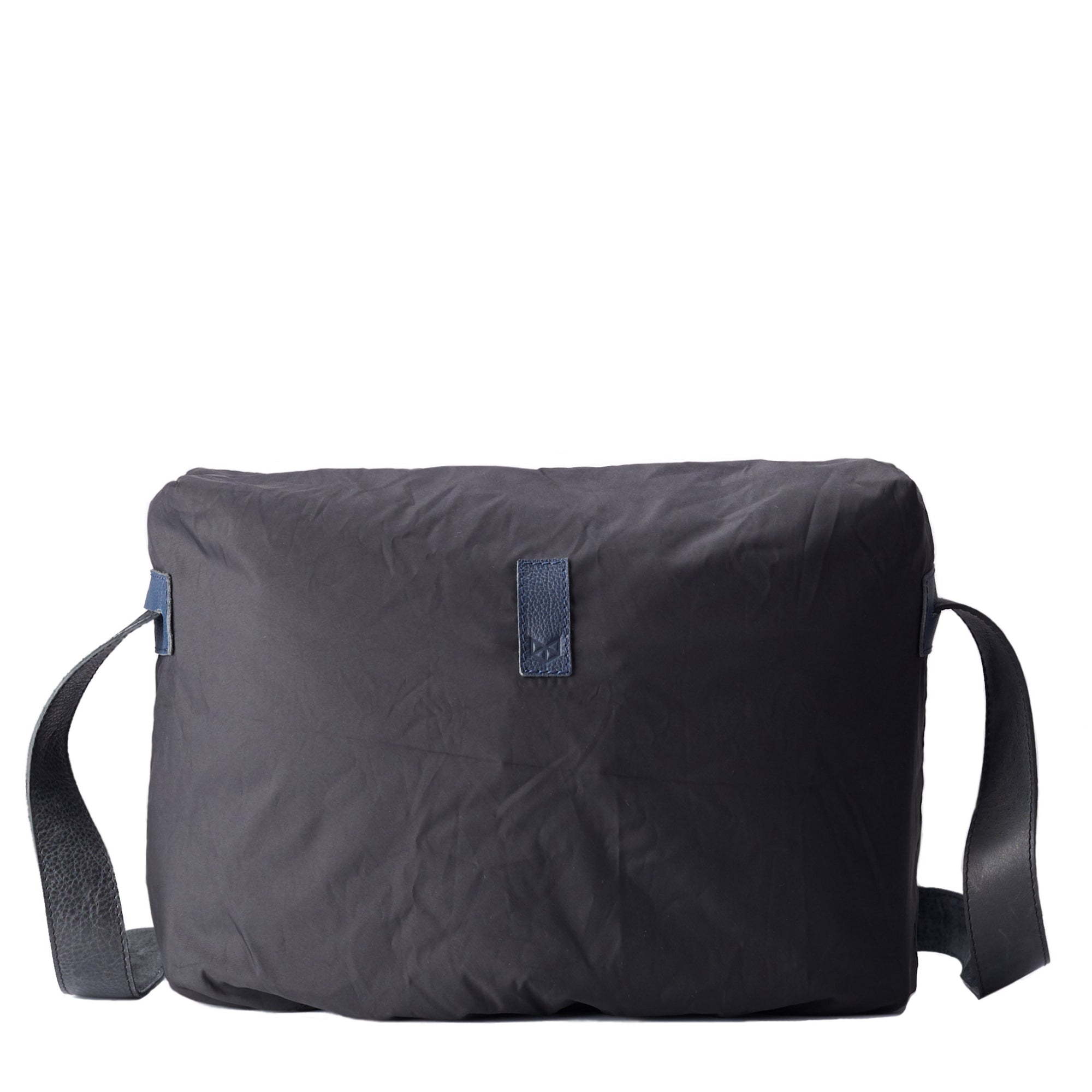 Front rain cover . Black rain cover perfect fit for all Capra messenger bags. Fashionable matte waterproof material. Leather details by Capra Leather.