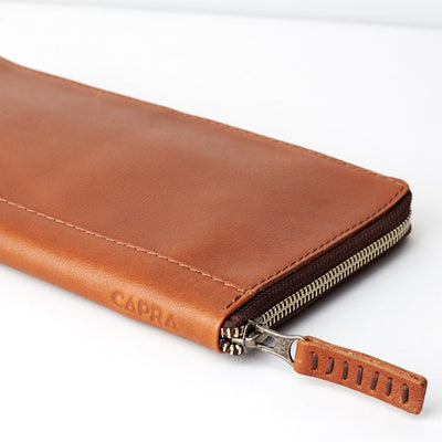 Slider and side view. Tan leather passport holder. Airport travel leather organizer accessories. Leather good craft by Capra Leather.