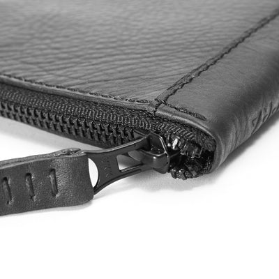 Detail black leather passport wallet. Perfect for travelers. Gift for men by Capra Leather.