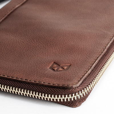 Close up. Brown leather passport for travelers, gifts for men. Travel journal, document organizer holder