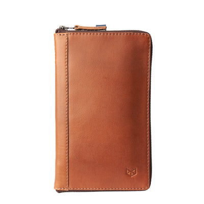 Front view. Tan leather passport holder. Airport travel leather organizer accessories. Leather good craft by Capra Leather.