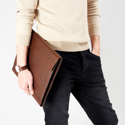 Style model walking with portfolio. Brown laptop tablet portfolio. Business document organizer for men.