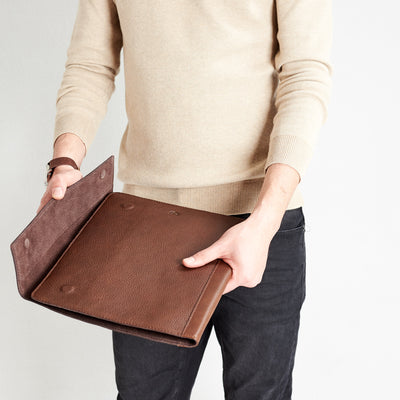 Style pockets detail. Brown laptop tablet portfolio. Business document organizer for men.